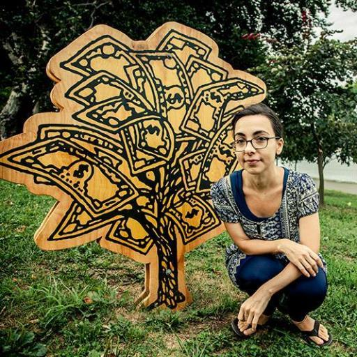 Potrait of Anne Percoco with her artwork (a tree sculpture installed outdoors)